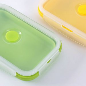 Detail of two closed lunch boxes with silicone valve.