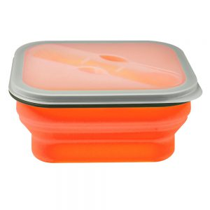 Detail of the folding silicone lunch box with a bowl and deployed cover.