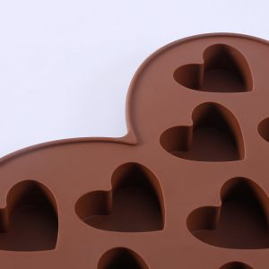 Detail of silicone shaped chocolate mold with hearts - 0