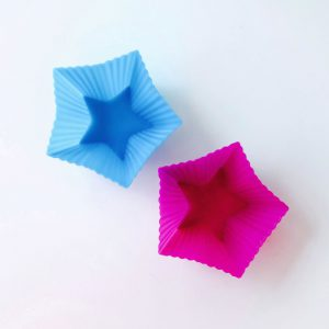 Top detail of two 5-pointed star silicone molds for LOE cupcakes